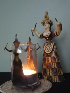 snake goddess statue and candle